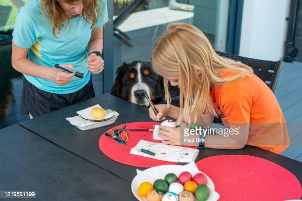 mother and son enjoying creative day in easter egg coloring - happy resurrection day stock pictures, royalty-free photos & images
