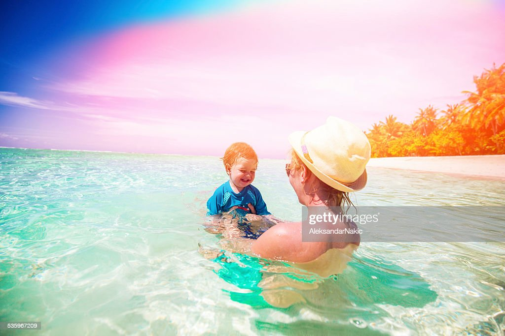 Mother and son enjoying in the sea : Stock Photo