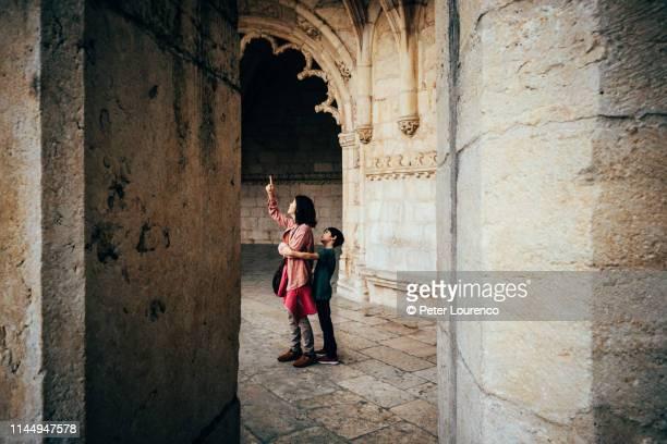 mother and son exploring a church - peter lourenco stockfoto's en -beelden