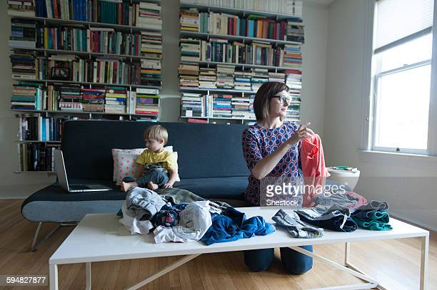 Mother and son folding laundry