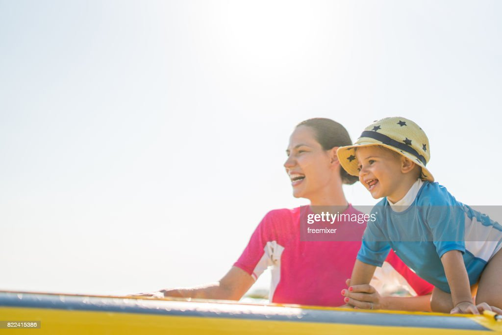 MOther and son going to surf : Stock Photo