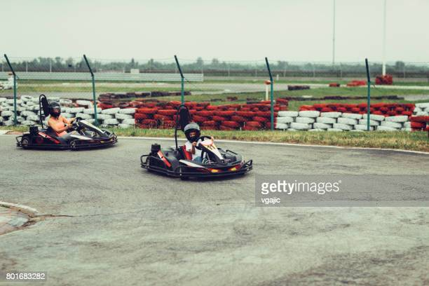 mother and son go-karts - go cart stock pictures, royalty-free photos & images