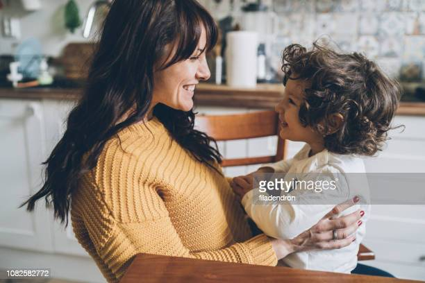 mother and son happy together - face to face stock pictures, royalty-free photos & images