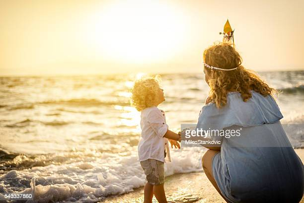 mother and son have a fun at the beach - mothers day beach stock pictures, royalty-free photos & images