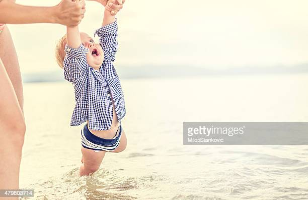 Mother and son have a fun in the sea