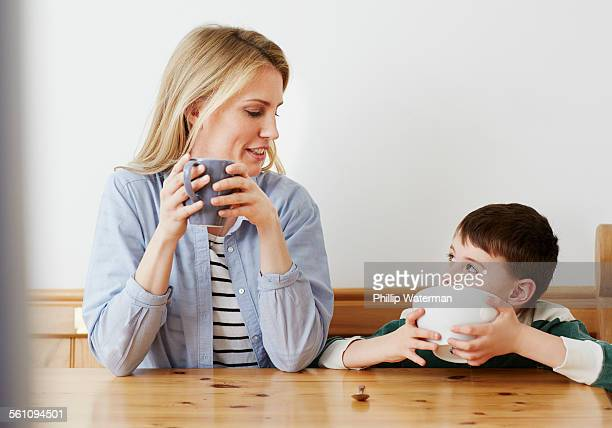 Mother and son having breakfast