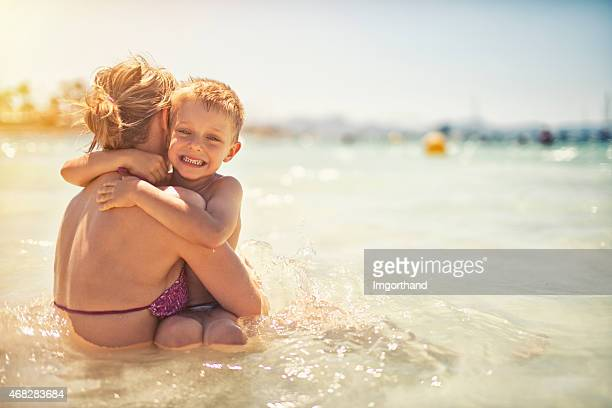 Mother and son having fun in sea