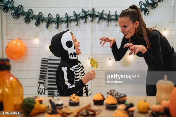 mother and son having fun on halloween - halloween cats stock pictures, royalty-free photos & images