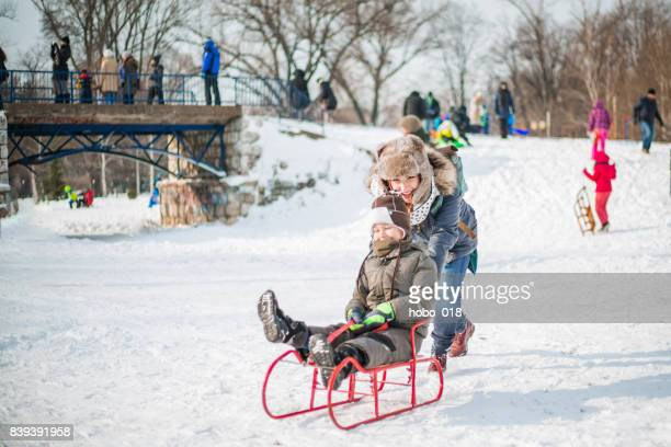 Mother and son having fun on snow
