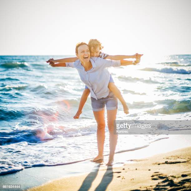 Mother and son having fun on the beach