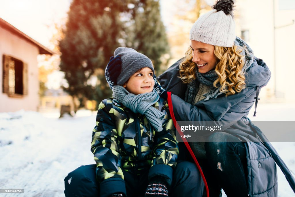 Mother and Son Having Fun Outdoors At Winter : Stock Photo