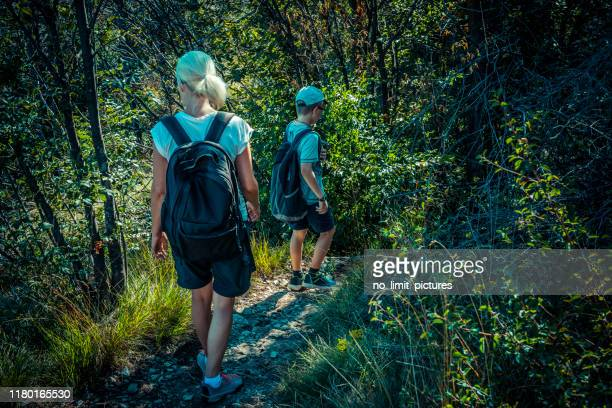 mother and son hiking - narrow stock pictures, royalty-free photos & images