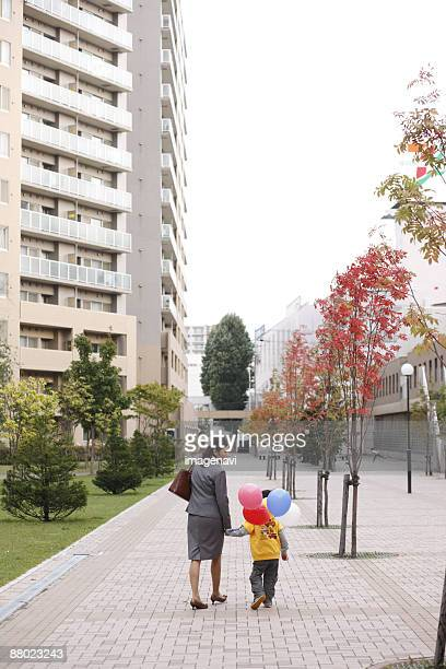 Mother and son holding balloons
