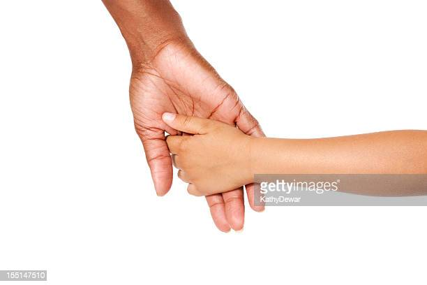 A mother and son holding hands