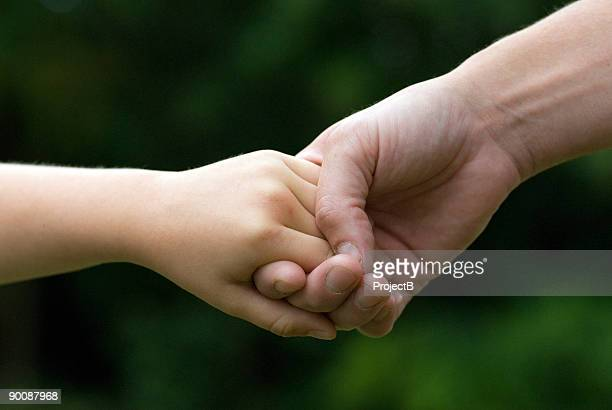 mother and son holding hands - goose bumps stock pictures, royalty-free photos & images