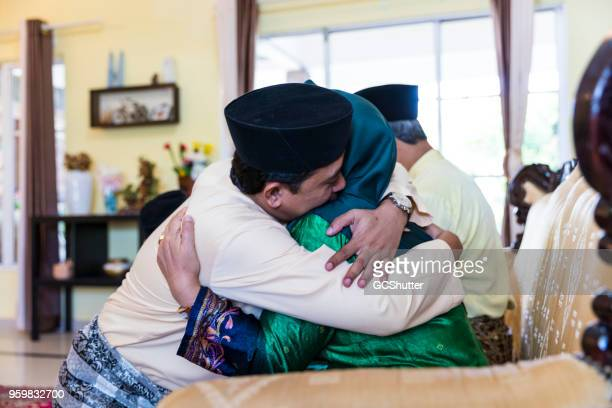 Mother and Son hugging each other during a festive celebration