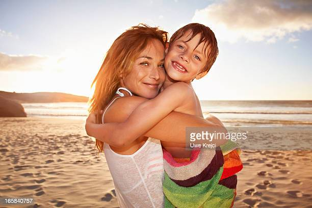 Mother and son hugging on beach