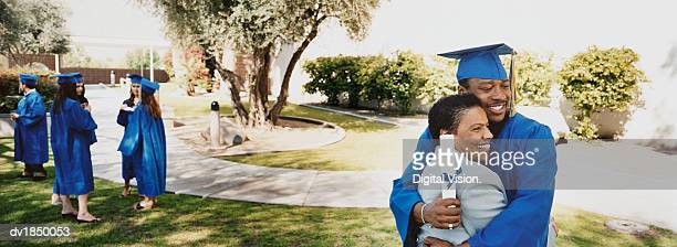 Mother and Son Hugging on Campus at His Graduation