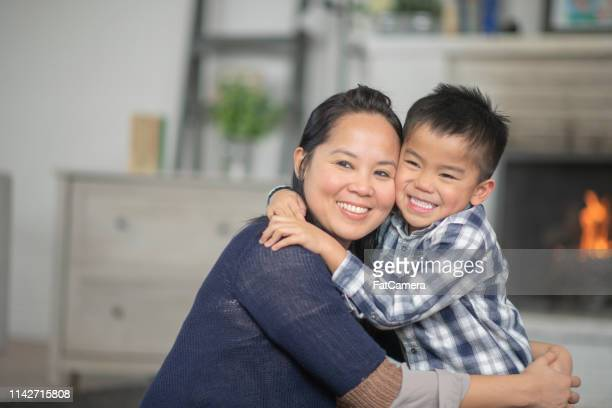 mother and son hugging - daily life in philippines stock pictures, royalty-free photos & images
