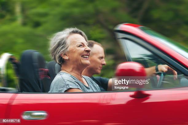 mother and son in a convertible - domestic car stock pictures, royalty-free photos & images