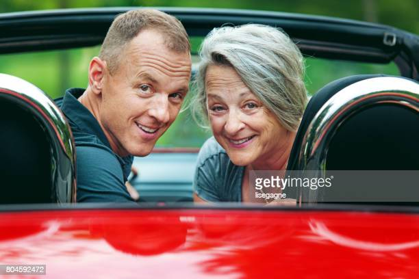 Mother and son in a convertible
