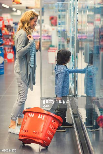 Mother and Son In A Supermarket