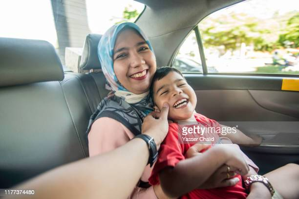 Mother and Son in a Taxi car