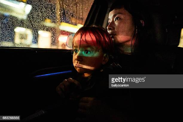 mother and son in back of car. - mother son shower stock photos and pictures
