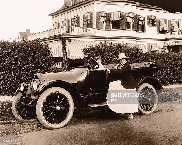 mother and son (4-6) in convertible car, portrait (b&w sepia tone) - 1920 car stock photos and pictures