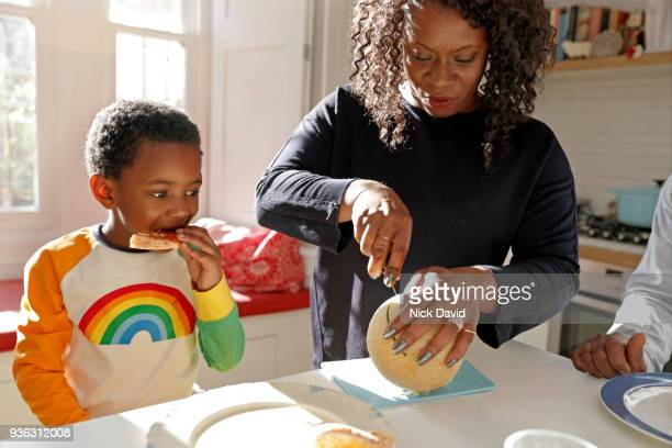 mother and son (4-5) in kitchen - lunch stock pictures, royalty-free photos & images