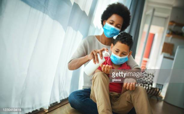 mother and son in pandemic quarantine. - pandemic illness stock pictures, royalty-free photos & images