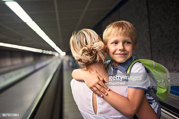 Mother and son in Rome metro moving walkway