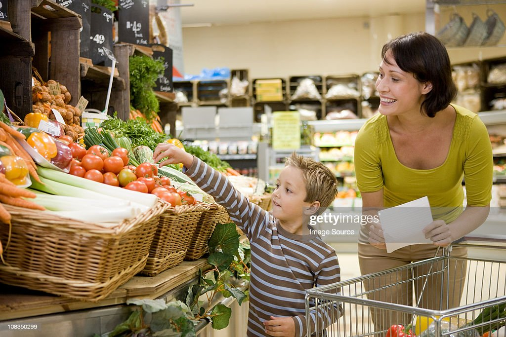 Mother and son in supermarket : Stock Photo