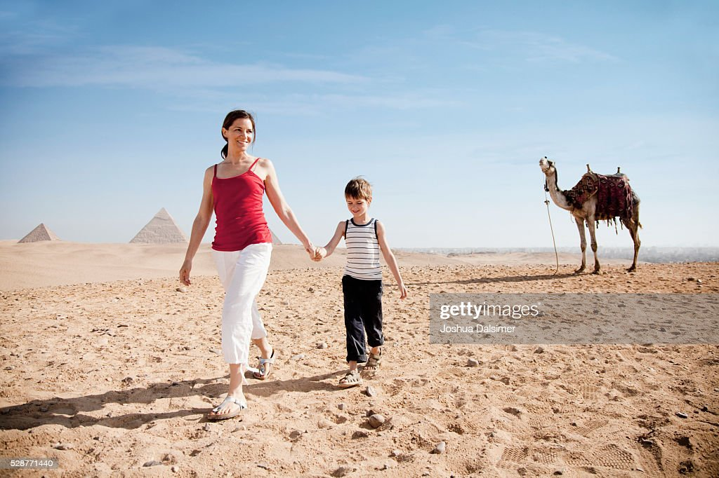 Mother and son in the desert : Stock Photo