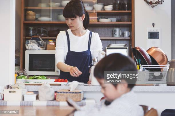 mother and son in the dining kitchen at home - homemaker stock pictures, royalty-free photos & images