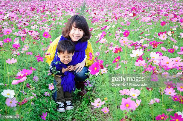 Mother and son in the flowers.