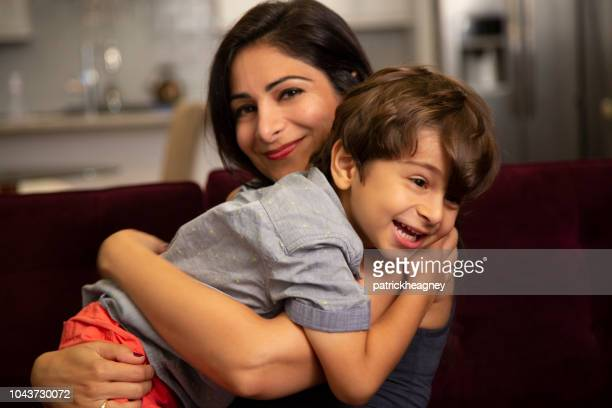 mother and son indoors - persian stock photos and pictures