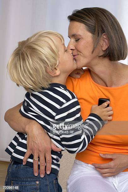 mother and son (4-5 years) kissing - 4 5 years photos stock pictures, royalty-free photos & images