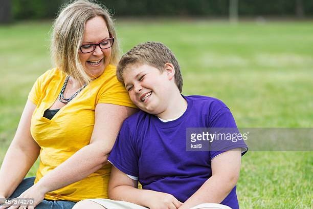 mother and son laughing in the park - pre adolescent child stock pictures, royalty-free photos & images
