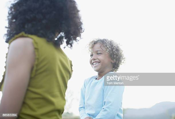 Mother and son laughing outdoors