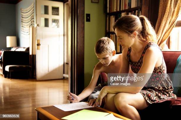 Mother and son learning indoors