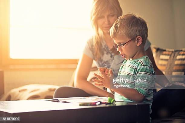 Mother and son learning to count