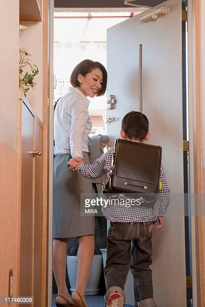 Mother and son leaving for work and going to school