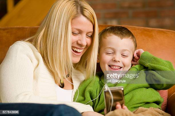 Mother and Son Listening to MP3 Player