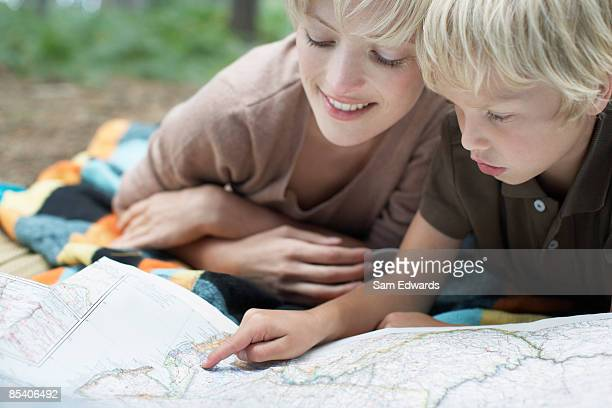 Mother and son looking at map
