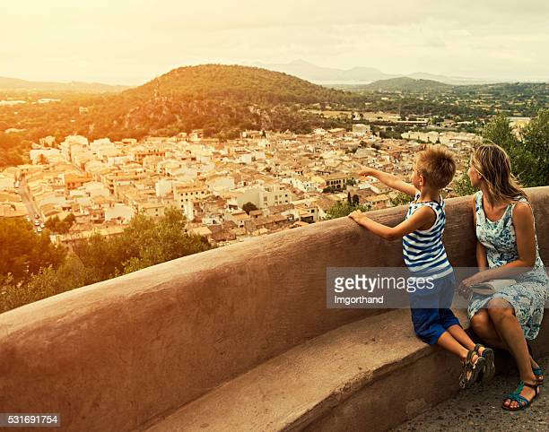 Mother and son looking at mediterranean view of Mallorca town