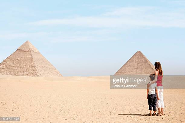 Mother and son looking at pyramids