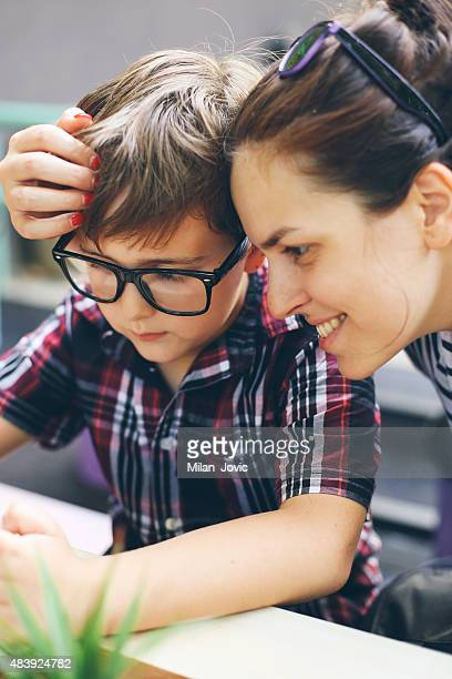 Mother and son looking at video game