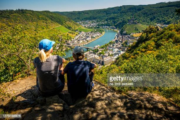 mother and son looking down to cochem and river mosel in germany - moselle stock pictures, royalty-free photos & images
