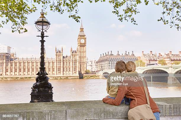 Mother and son looking over river at big ben